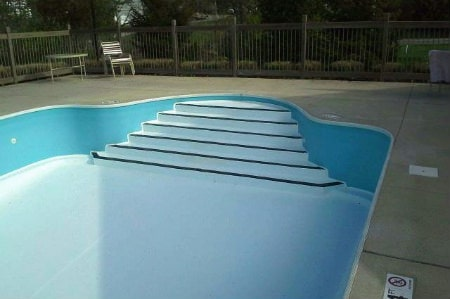 commercial pool painted bright white