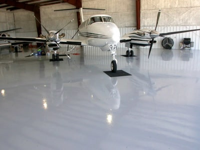 aircraft hanger epoxy floor coated by our team