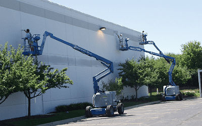 image of modern painting workers painting the exterior of a commercial building